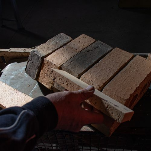 Checking hand made bricks