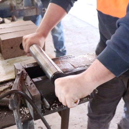 Rolling a smooth finish to hand made brick
