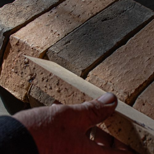 Checking hand made bricks